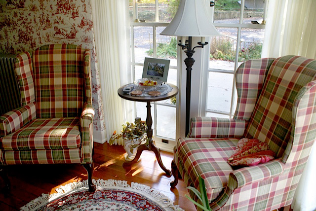 Huge windows overlooking the park grounds surround you as you settle back in the wing back chairs facing a big stone fireplace.