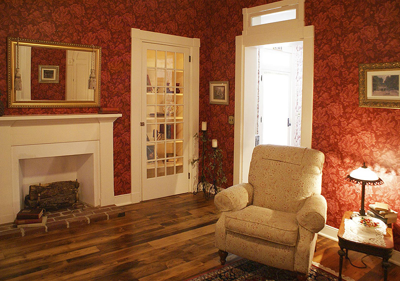 The library sits in the very center of the Mansion House. Complete with antique books, current newspapers and magazines, this room is inviting and cozy with its warm hardwood floors and oriental rugs. Open the beautiful corner cabinet enclosing a television for guest use.
